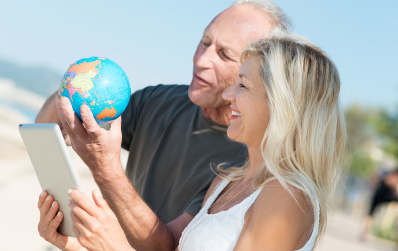 Happy senior couple planning retirement travel