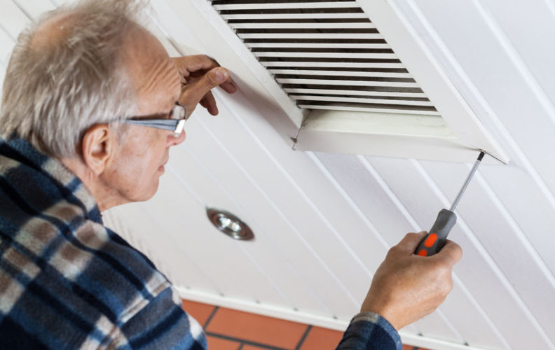 Senior dealing with home maintenance