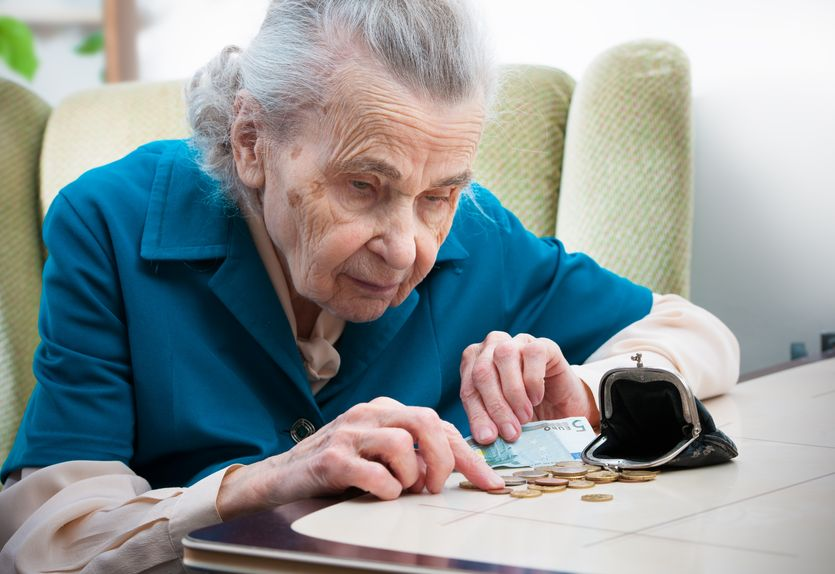 Senior woman counting her finances