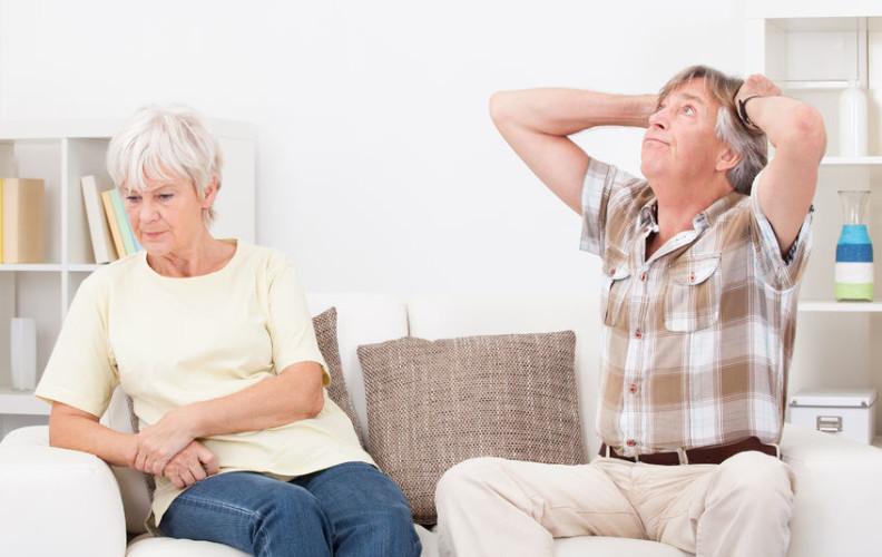Frustrated senior couple over being a caregiver
