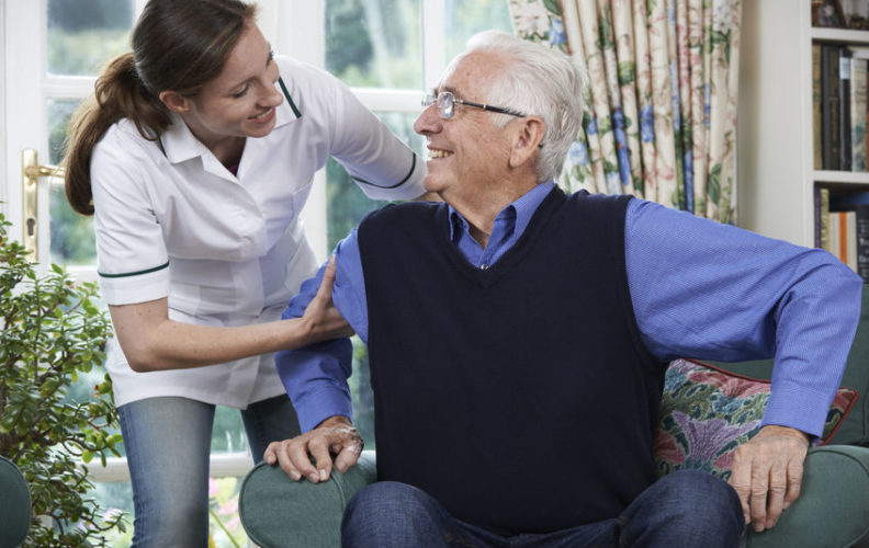 Man receiving help from an in-home care worker