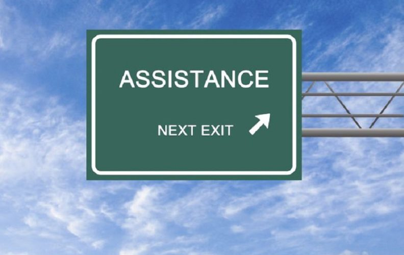 Sign pointing to assistance programs